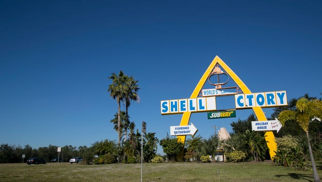 The Shell Factory's sign remains damaged in December after Hurricane Irma's landfall in September. Many other business signs are also damaged.