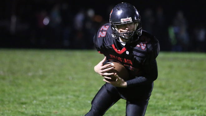 Santiam's Colin Thurston runs the ball as the Wolverines fall to St. Paul 29-27 in a Tri-River Conference game on Friday, Oct. 7, 2016, at Santiam High School in Mill City.