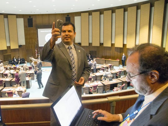 State Rep. Mark Cardenas takes photos of journalists,