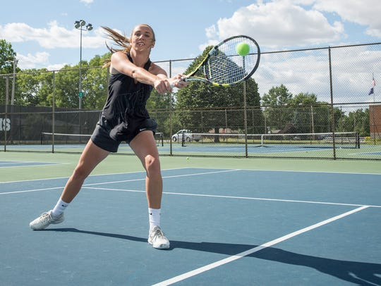 Yorktown's Maddie Minniear practices with her doubles