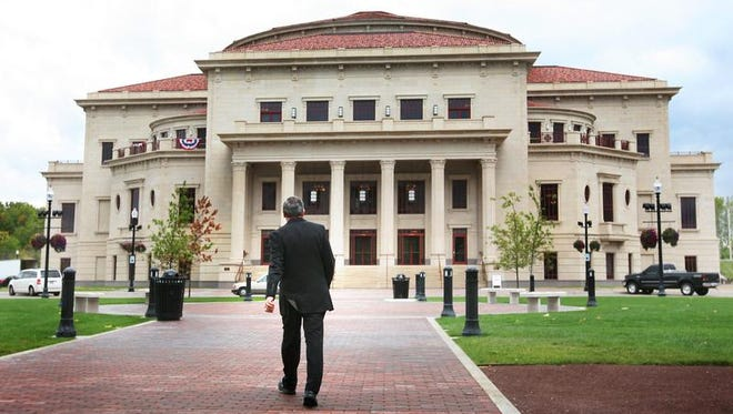 Frank Basile, the former interim CEO of The Center for the Performing Arts in Carmel (Palladium, The Tarkington Theater and The Studio Theater), walks toward the Palladium.