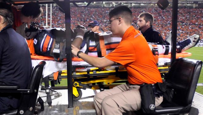 Auburn linebacker Cassanova McKinzy (8) is taken off the field an put into an ambulance during the game at Jordan-Hare Stadium on Saturday, Oct. 5, 2013.