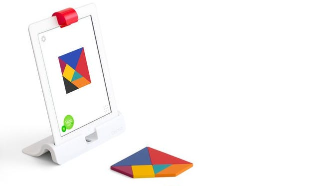 With the Osmo peripheral attached to an iPad, kids can manipulate real toys to play games on the iPad.