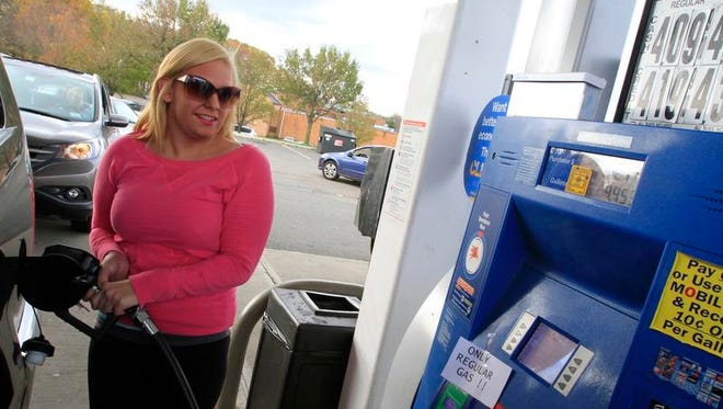 Ashley Telesman of Pearl River fills up her tank at the Mobile gas station on Route 59 in Nanuet after waiting for 45 minutes on Nov. 1, 2012.