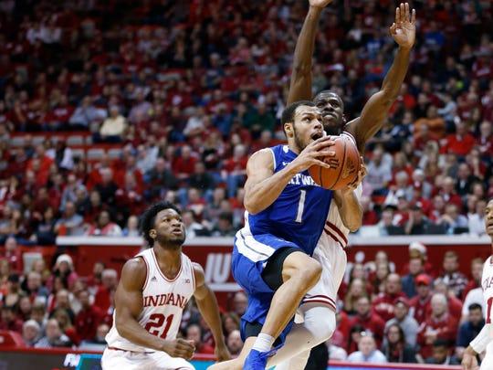 Fort Wayne's Bryson Scott (1) goes to the hoop against