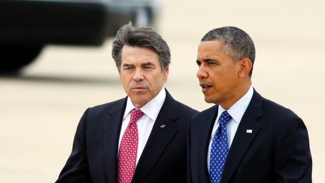President Obama and Rick Perry in 2013.