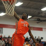 Naradain James dunks the ball in the closing seconds as Mansfield Senior defeats Toledo Bowsher 66-50 in the Division I regional semifinals at Lima Senior High School. James is just one of two returnees to the Tygers this season.