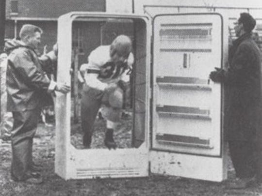 Image shows a football player running through a refrigerator