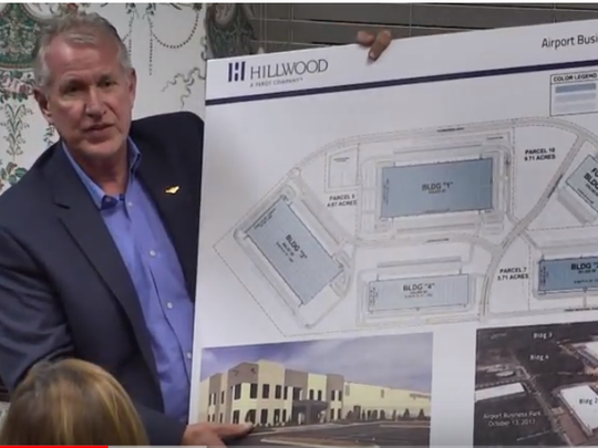 John Black, executive director of the Smyrna/Rutherford County Airport Authority, shows off an Airport Business Park Master Plan in 2017 that includes two completed buildings and two proposed buildings.