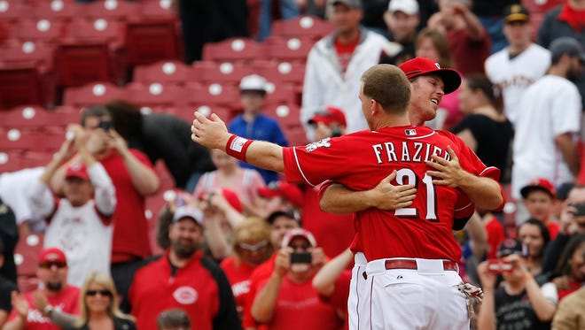 Todd Frazier embraces Brennan Boesch, after Marlon Byrd hit a game-winning single to beat the Pirates 3-2 at Great American Ball Park Thursday.