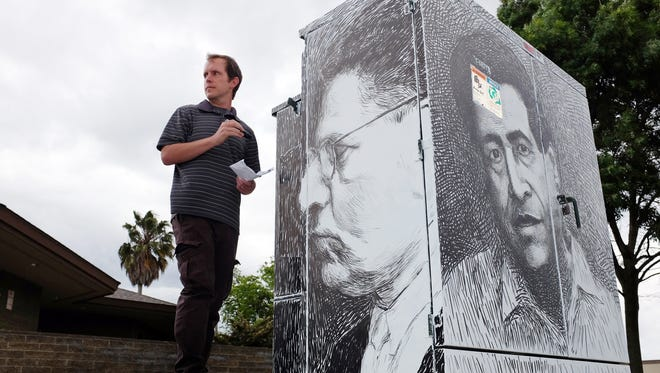 Artist Drew McSherry touching up a portrait of Mexican great JosŽé Clemente Orozco. The untitled work covers all four sides of the PG&E box at the corner of Bardin Way and Williams Road in east Salinas.