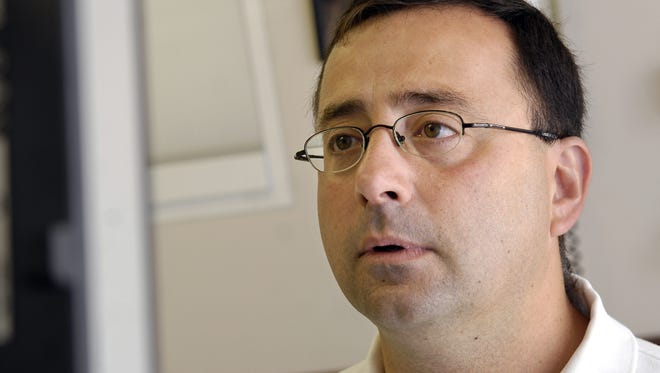 The Attorney General's Office will review the investigation of former Michigan State University doctor Dr. Larry Nassar, shown in this 2008 file photo, for possible criminal charges.