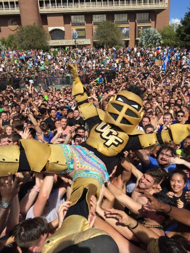 Knightro crowd surfs at Spirit Splash on Oct. 23, 2015