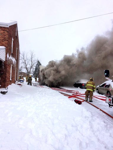 A garage fire has led to the closure of Route 116 between