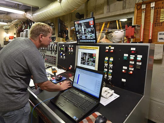 Engineer Keith Trewyn of Marine Automated System Technologies monitors the sulfur oxides among other properties on the James R. Barker.