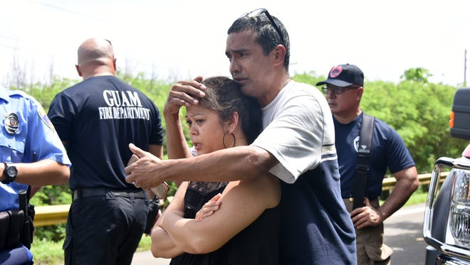 Family members grieve Friday morning as firefighters prepare to transport a man who was found dead after he went crab hunting Thursday night and failed to return. The hunter was identified as Ricardo B. Villagomez of Talofofo, by nephew Matthew Iglesias of Chalan Pago.