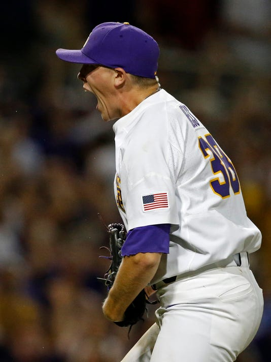 LSU pitcher Zack Hess (38) reacts after striking out the last batter in the team's NCAA college baseball tournament super regional game against Mississippi State in Baton Rouge, La., Saturday, June 10, 2017. LSU won 4-3. (AP Photo/Gerald Herbert)
