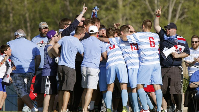 Lansing United's players and fans celebrate Danny Cawley's goal in the second half against the Michigan Stars last season. United will begin its fourth year as a club in May.