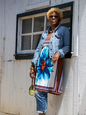 Tracey ReNissa Crews tops her cut up jeans from Macy's with a multi-colored floral sundress  and a cropped denim jacket from the Gap.