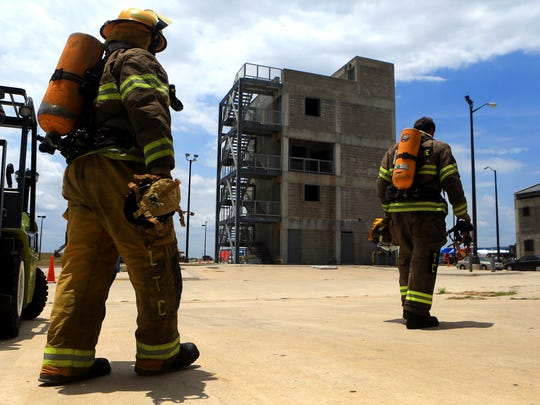 Cadets from the Del Mar College Regional Fire Academy prepare to extinguish flames overtaking various practice props during a training exercise Tuesday, July 31, 2017, at Del Mar College-West Campus in Corpus Christi.