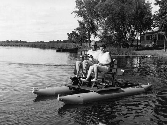 Ambrose and Marie Weeres take a ride on a paddleboat on the Horseshoe (Sauk River) Chain of Lakes in 1955. Weeres and Edwin Torborg invented the pontoon boat in Richmond in the 1950s.