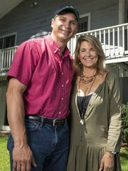 Tracie and Vince Carlos pose for a portrait at their