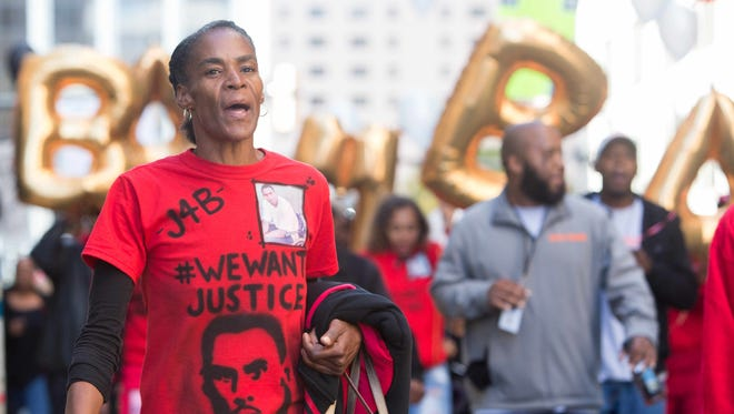 """Phyllis McDole, mother of Jeremy """"Bam"""" McDole, takes part in a march down Orange Street and a rally in Rodney Square in Wilmington on Friday."""