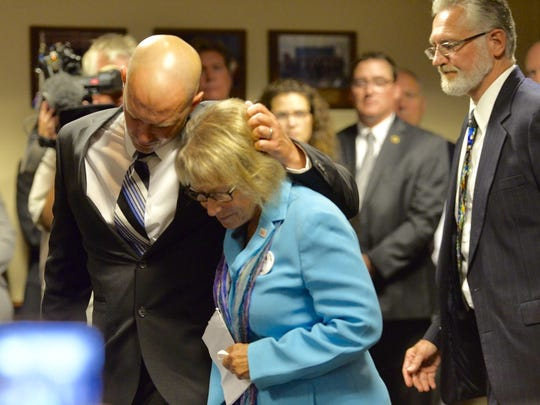 Patty Wetterling is comforted by her son, Trevor, after speaking at a press conference Tuesday in federal court where suspect Danny Heinrich admitted to the abduction and murder of Jacob Wetterling.