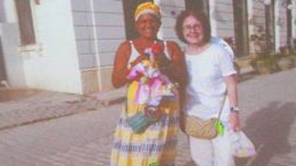 A great photo of Judy-Ann next to a flower vendor near Havana.
