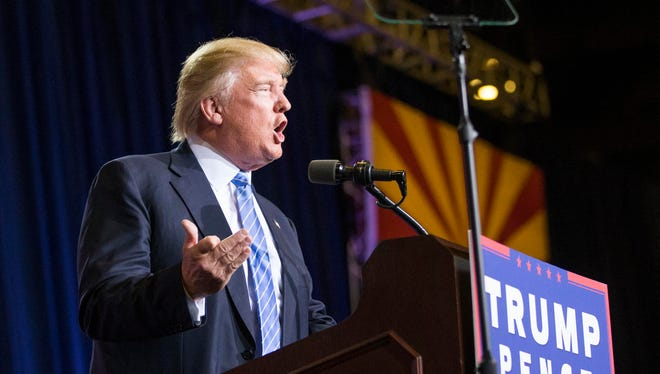 Republican presidential candidate Donald Trump speaks to a crowd at the Phoenix Convention Center.
