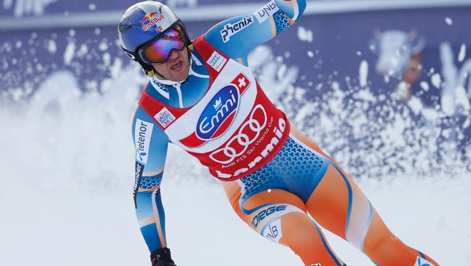 Norway's Aksel Lund Svindal celebrates after winning an alpine ski, men's World Cup downhill, in Bormio, Italy, Sunday