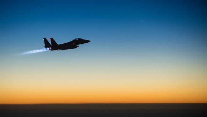 A U.S. attack aircraft flies over northern Iraq after conducting airstrikes in Syria last week.