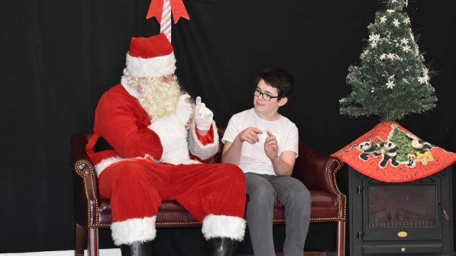 A child speaks with Santa Claus during the 2019 Signing with Santa event, hosted by Deaf and Hard of Hearing Services. DHHS is holding the event again Saturday, Dec. 5, 2020, albeit with coronavirus safety precautions.