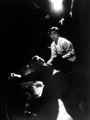 Busboy Juan Romero tries to help Sen. Robert Kennedy after he was cut down by an assassin's bullets in 1968 at a hotel. Kennedy lingered for a day, but doctors couldn't save him.