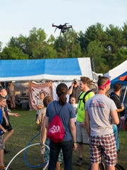 A drone hovers over a portion of the crowd at the GrassRoots
