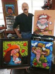El Paso artist Francisco Romero with sone of his work in his West El Paso studio.