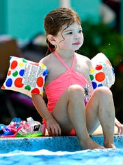 Ellery Krotzer, 3, of Manchester Township, sits on