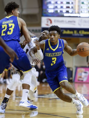 Delaware guard Anthony Mosley works around a pick set by teammate Skye Johnson on LaSalle's Johnnie Shuler in the first half in Philadelphia Tuesday.