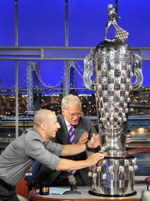 2013 INDY 500 winner Tony Kanaan, entices  Late Show host David Letterman to touch the Borg-Warner Trophy during Monday\'s 6/3 show taping in New York. Photo: John Paul Filo/CBS �©2013 CBS Broadcasting Inc. All Rights Reserved