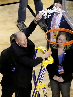 Villanova's Rev. Rob Hagan swings around the net after cutting the last string after their win over Texas Tech in an NCAA men's college basketball tournament regional final, Sunday, March 25, 2018, in Boston. Villanova won 71-59 to advance to the Final Four. (AP Photo/Mary Schwalm)