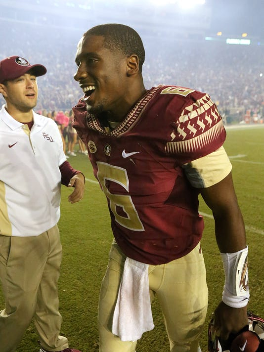 Florida State's Everett Golson celebrates a win over Miami in an NCAA college football game, Saturday, Oct. 10, 2015 in Tallahassee, Fla. Florida State won the game 29-24. (AP Photo/Steve Cannon)