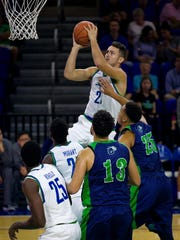 Florida Gulf Coast University guard Christian Carlyle puts up two points against Ave Maria University in the first period at Alico Arena on Tuesday.