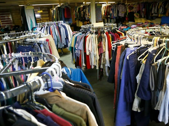 Donated clothes fill the area of the non-profit, Reaching Out, in the basement of Armor Bearers Ministries at 200 Ashland Road in Mansfield. The non-profit has recently been asked to vacate the property from the pastor of Armor Bearer Ministries.