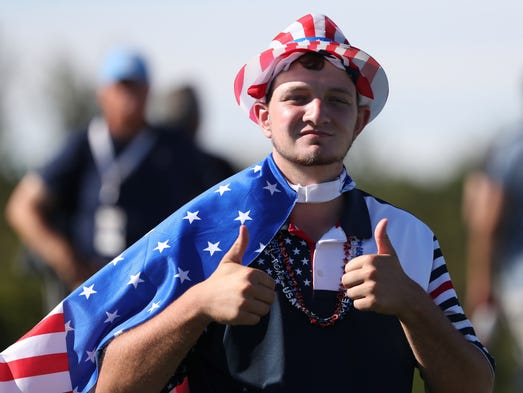 A USA fan shows his support during a first round foursomes