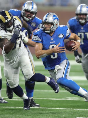 Lions quarterback Matthew Stafford runs the ball against the Los Angeles Rams during the first half Sunday, Oct. 16, 2016 at Ford Field in Detroit.