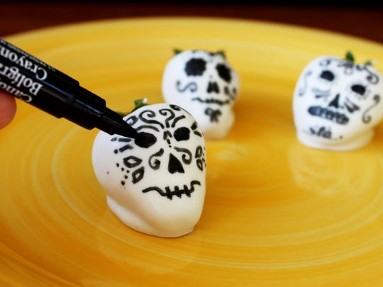 White chocolate covered sugar skull strawberries