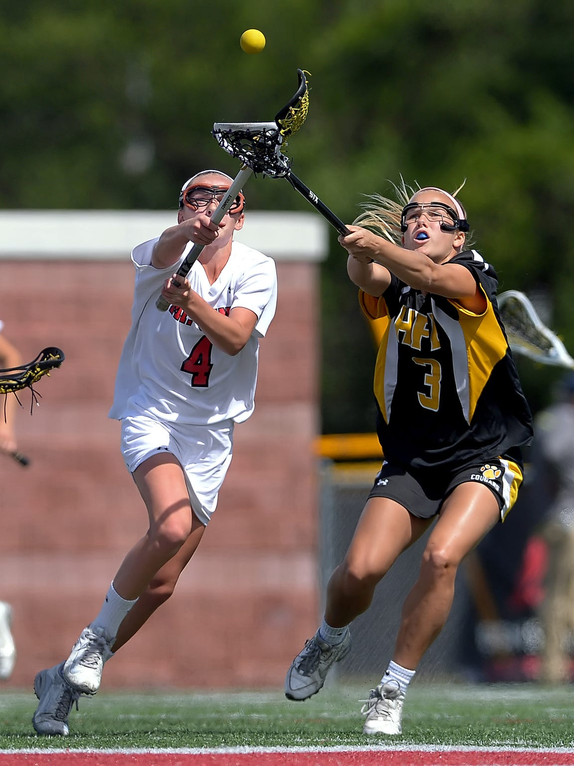 Mount Sinai's Emma Tyrrell, left, and HF-L's Caitlin