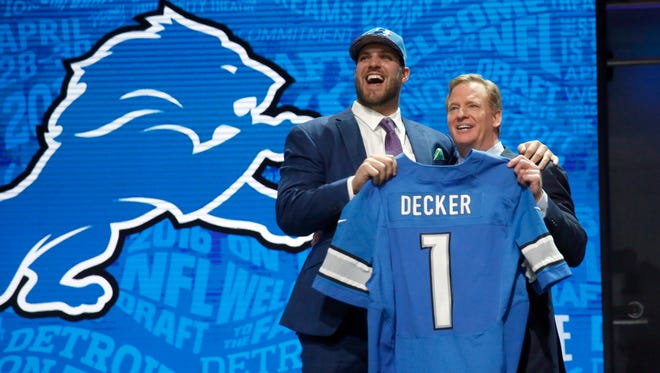 Taylor Decker poses for photos with NFL commissioner Roger Goodell after being selected by the Lions Thursday night.