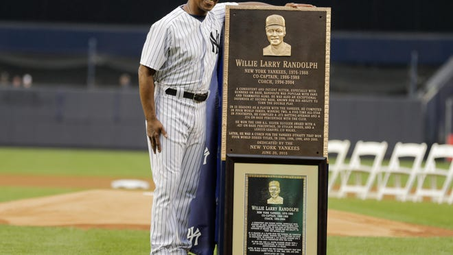 Willie Randolph poses for photograph with a plaque he was awarded during opening ceremonies for the Old-Timers' Day baseball game Saturday, June 20, 2015, at Yankee Stadium in New York.