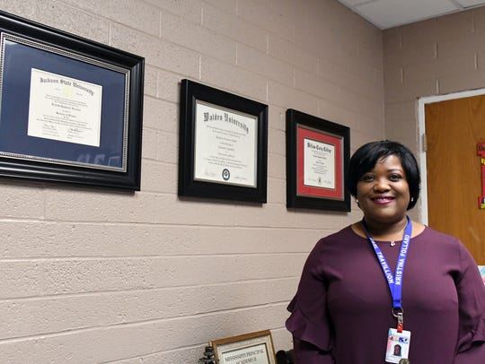 As principal of Earl Travillion Attendance Center, Kristina Pollard has helped raise the school's ranking from an F to a D and increase the passing rate on the state's third-grade reading test from 60 to 91 percent.